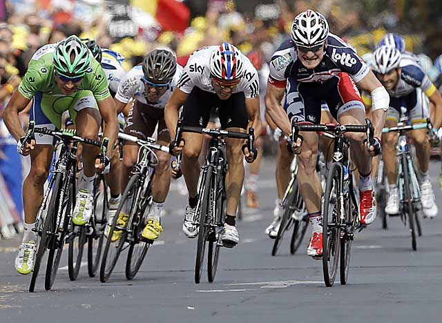 Greipel (right) beats out top sprinter Peter Sagan, wearing the green jersey, to take the 13th stage. (AP)
