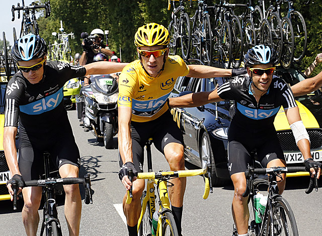 Wiggins, in yellow, and teammate Christopher Froome (left) finish the Tour 1-2. (Getty Images)