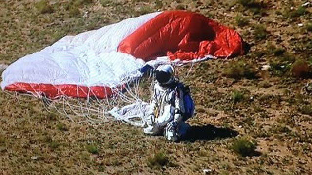 Felix Baumgartner enjoys the moment after his harrowing feat. (AP)