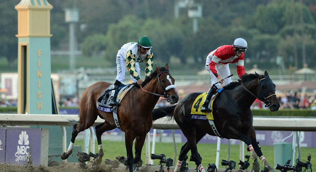Fort Larned, a 9-1 longshot, beats Mucho Macho Man to take the $5 million Classic. (Getty Images)