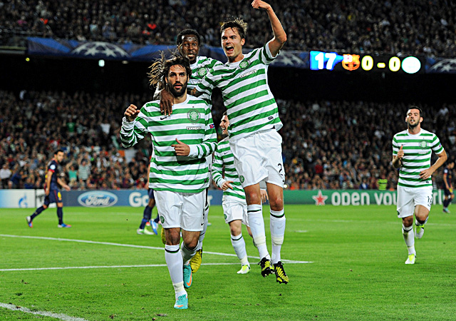 Celtic's Giorgos Samaras (left) celebrates a goal with Mikael Lustig in a win over Barcelona. (Getty Images)