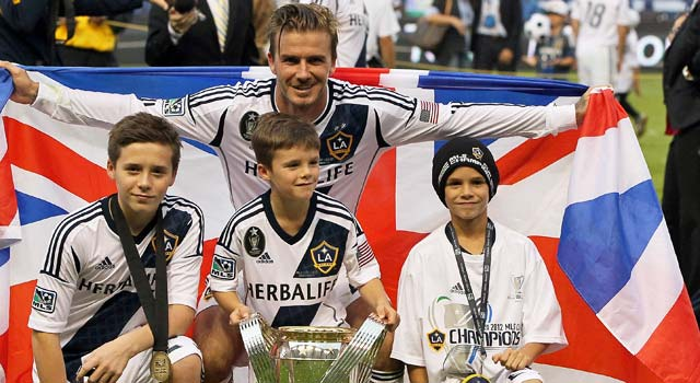 David Beckham poses with his sons as he finishes his MLS career in style. (Getty Images)