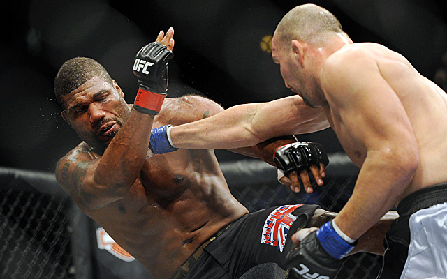 Glover Teixeira (right) connects with a right punch, knocking Rampage Jackson down to the canvas. (US Presswire)