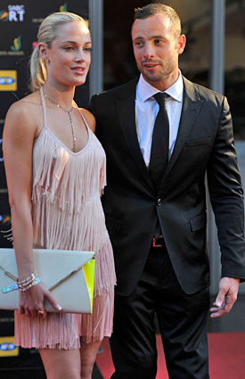 Reeva Steenkamp and Oscar Pistorius had been dating for a few months, according to the sprinter's former coach. (Getty Images)