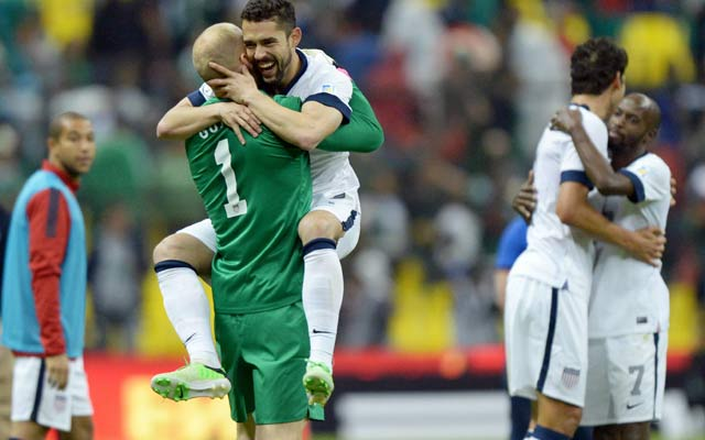 Herculez Gomez and goalie Brad Guzan celebrate a rare American point at Azteca Stadium. (USATSI)
