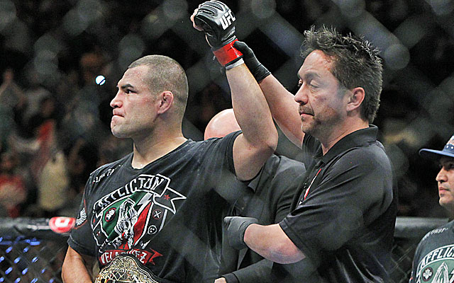 Cain Velasquez finishes off Antonio Silva in the first round to retain his heavyweight title. (USATSI)