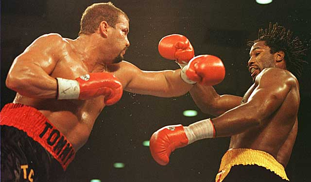 Tommy Morrison trades shots with Lennox Lewis in their 1995 bout. (Getty Images)