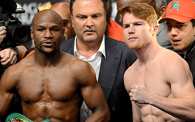 Floyd Mayweather and Canelo Alvarez at Friday's weigh-in. (USATSI)