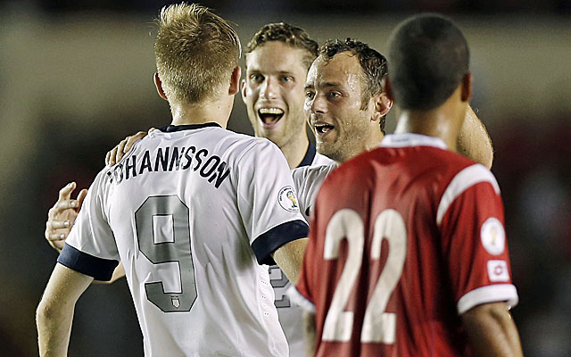 Aron Johannson celebrates with his US teammates after scoring his first international goal to beat Panama. (USATSI)