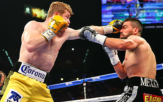 Canelo Alvarez connects with his left hand against Alfredo Angulo in Las Vegas. (Getty)