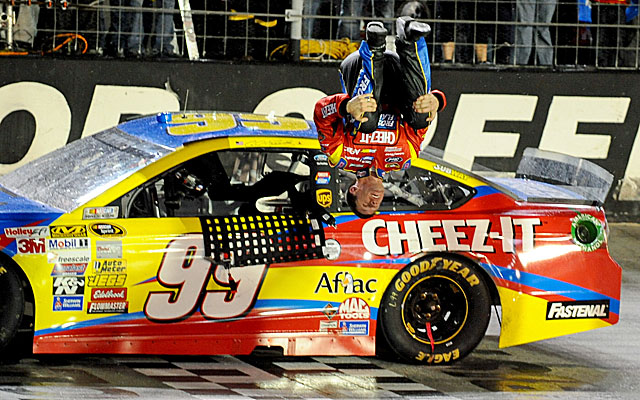 Carl Edwards does a backflip after waiting out the rain to win at Bristol. (USATSI)