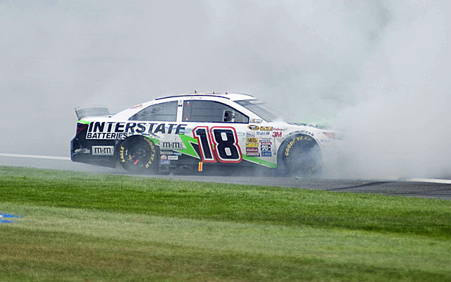 Kyle Busch smokes the tires after winning at Auto Club Speedway. (USATSI)