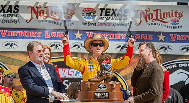 Joey Logano fires pistols Texas-style after winning the Duck Commander 500. (USATSI)