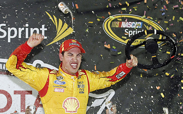 Joey Logano celebrates his victory Saturday night, the first of his career at Richmond. (USATSI)