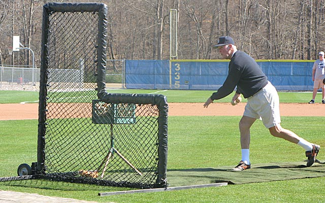 Despite three elbow surgeries and nagging pain, Coach Hendley still pitches BP at Stratford alumni festivities.    (Provided to CBSSports.com)