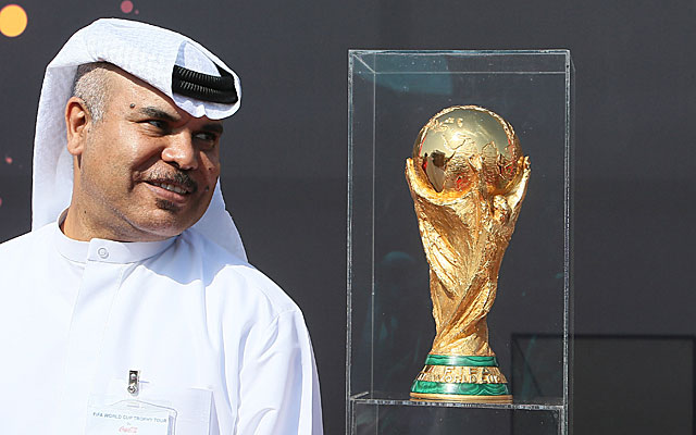 A Qatari official poses with the World Cup trophy during a tour last year.  (Getty)