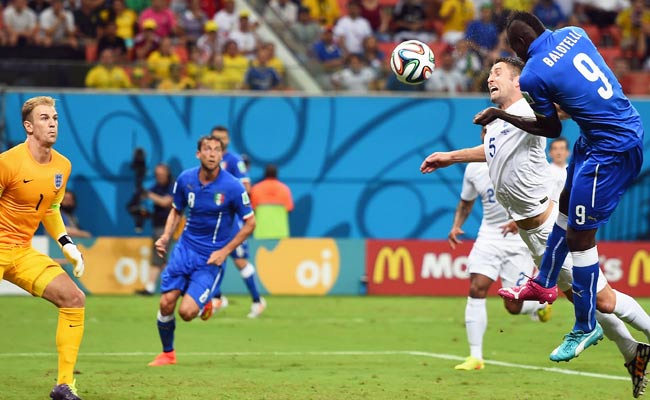 Marco Balotelli knocks it in for the decisive goal for Italy. (Getty Images)