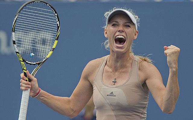 Caroline Wozniacki celebrates her 3-set victory over Maria Sharapova. (USATSI)