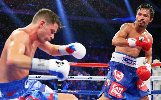 Manny Pacquiao knocks down Chris Algieri on his way to a clear and decisive victory. (Getty Images)