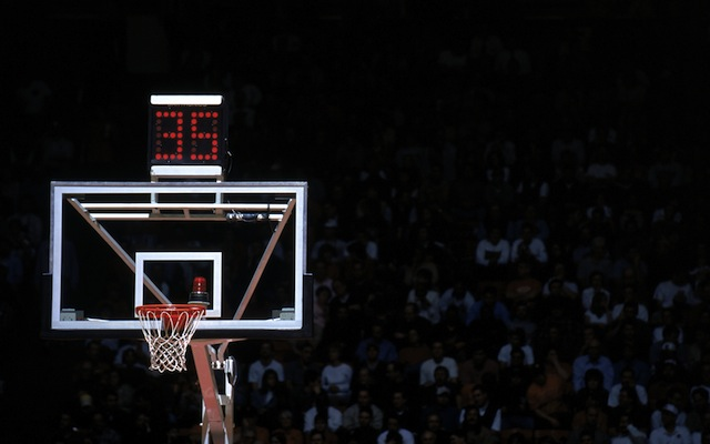 The 35-second shot clock has been used in men's college hoops since 1993-94.  (Getty Images)