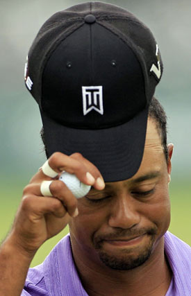 Tiger Woods hits one of his first 10 fairways on Friday. (AP)