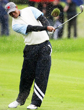 For most of the morning, Tiger Woods didn't even bother with half of his U.S.-issued raingear. (Getty Images)