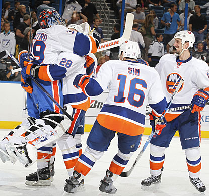 After a lengthy wait for a video review, Rick DiPietro and the Islanders can celebrate their win. (Getty Images)