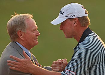 Tournament host Jack Nicklaus congratulates Steve Stricker on the 18th green. (Getty Images)
