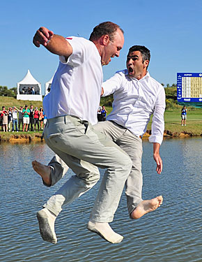 Thomas Levet (left) makes the leap that will have him sidelined for six weeks, knocking him out of the British Open. (Getty Images)