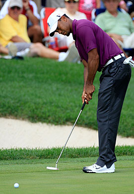 Tiger Woods finishes the opening round with three birdies. (Getty Images)