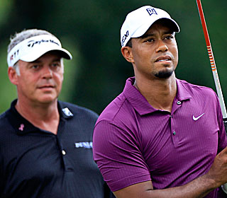 'He played lovely,' says Tiger's playing partner for the day, Darren Clarke. '... Pleased to see.' (Getty Images)