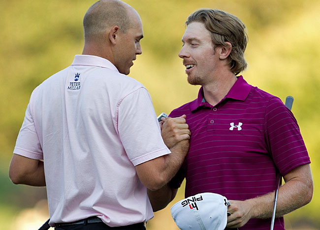 The stakes were high and in the end Hunter Mahan (right) congratulates Bill Haas. (US Presswire)