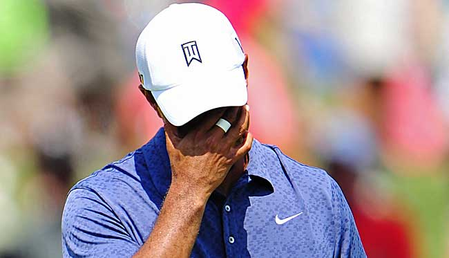 The last time we saw Tiger, he was missing the cut at the PGA while sinking to 50th in the world. (Getty Images)