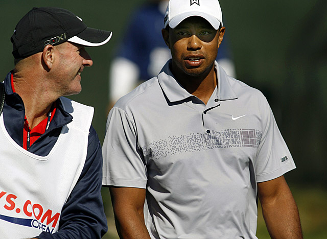 Tiger Woods and caddie Joe LaCava consult during second-round play at CordeValle. (AP)