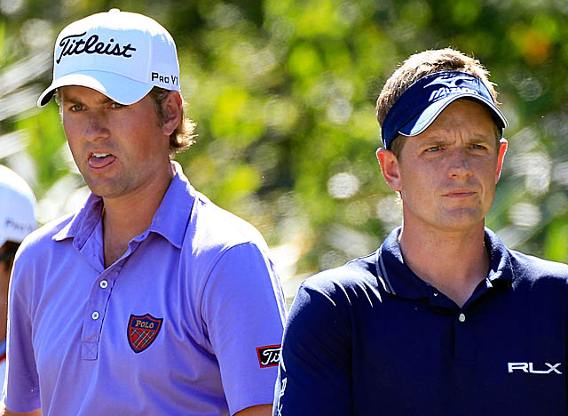 Leading Luke Donald (right) by 1 Sunday , Webb Simpson watches as the world No. 1 asserts himself. (Getty Images)