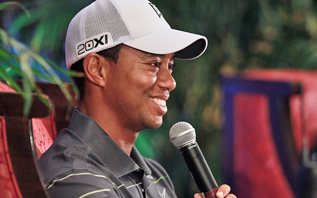Tiger Woods tries to keep the media horde in its place during Wednesday's news conference. (AP)