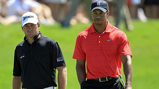 Is Tiger back to his intimidating ways? Sunday playing partner Graeme McDowell shoots 74 to tumble. (AP)