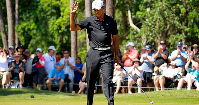 Tiger Woods shoots a 68 for the round, but is six shots behind entering the weekend. (Getty Images)