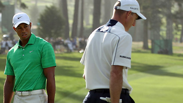 Woods and Jim Furyk go in different directions as only one holds his spot atop the leaderboard. (Getty Images)