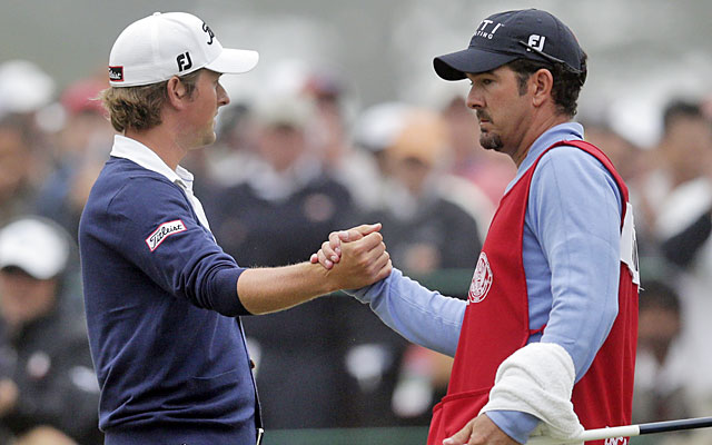 Webb Simpson accepts congratulations from his caddie after salvaging par on No. 18. (AP)