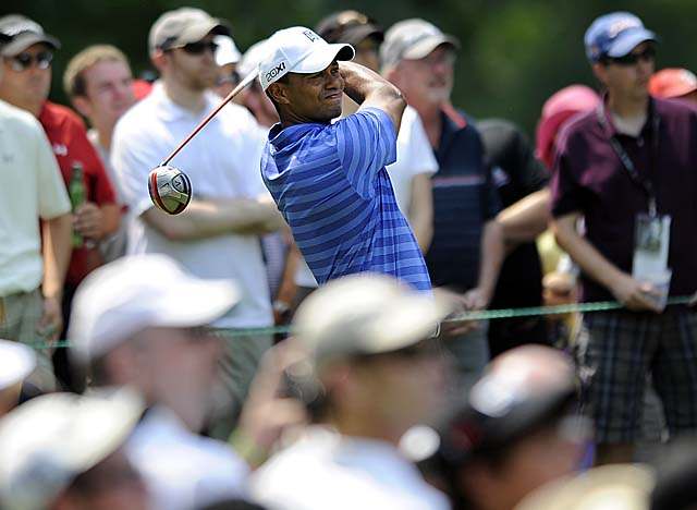 With the help of a 50-foot eagle on No. 16, Woods gets back into the mix Friday. (AP)