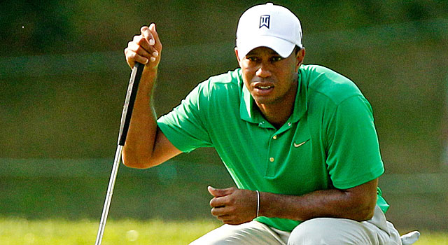 Tiger Woods shoots a 4-under 67 to share second place with Bo Van Pelt and Seung-Yul Noh. (US Presswire)
