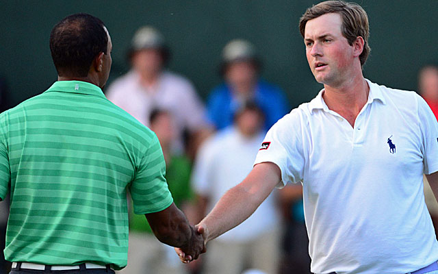 U.S. Open champ Webb Simpson and Greenbrier leader Webb Simpson shakes hands with Tiger. (US Presswire)
