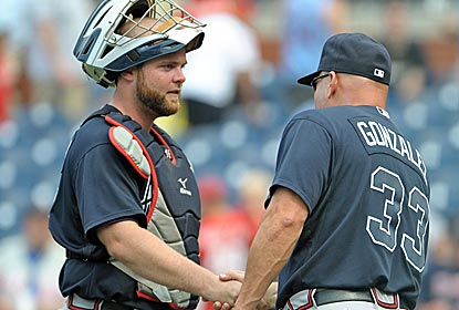 Braves catcher Brian McCann is congratulated by his manager after homering for the third consecutive game.  (US Presswire)