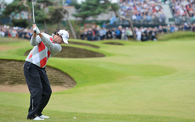 Adam Scott hits his approach at No. 13 on the way to one of his eight first-round birdies. (Getty Images)