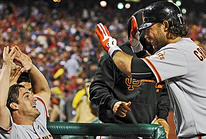 Giants shortstop Brandon Crawford is congratulated in the dugout after hitting a grand slam in Philly.  (Getty Images)