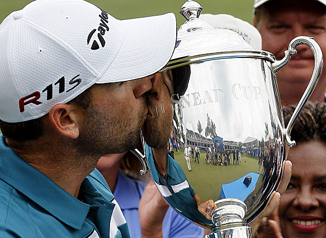 A bogey on 18 proved meaningless as Garcia wins the Wyndham title by two shots. (AP)