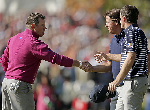 Europe's Lee Westwood congratulates Bradley and Mickelson on their win. (AP)