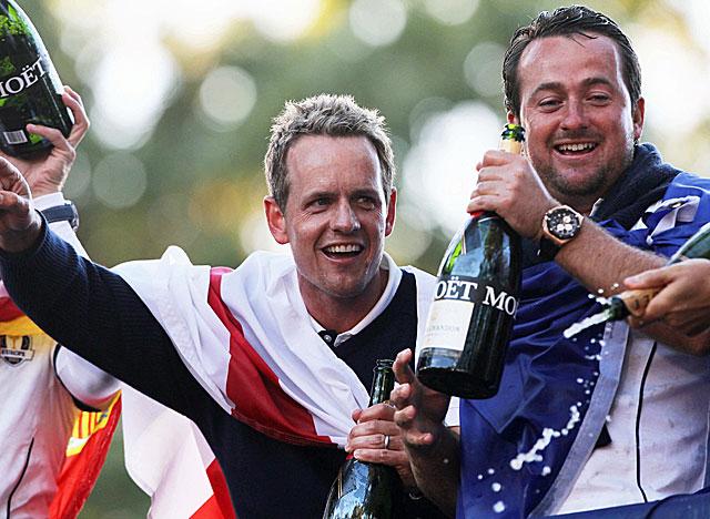 Luke Donald and Graeme McDowell celebrate Europe's win. (AP)