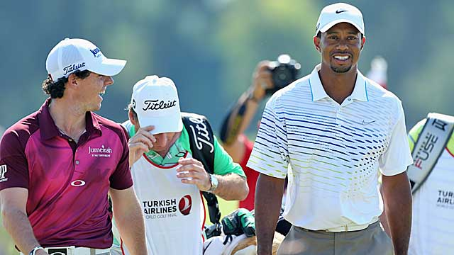 McIlroy shares a laugh with Woods during their match Thursday. (Getty Images)